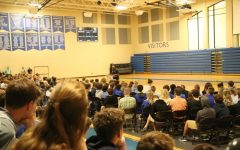 Upper school students listen to the second in-person chapel of the 2021-22 school year with Football Coach and Asst. Dean of Students, Mr. Butler B'ynote, speaking.