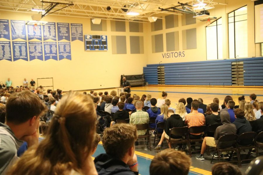 Upper school students listen to the second in-person chapel of the 2021-22 school year with Football Coach and Asst. Dean of Students, Mr. Butler Bynote, speaking.