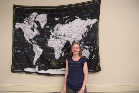 Senorita Dunn stands in her classroom.