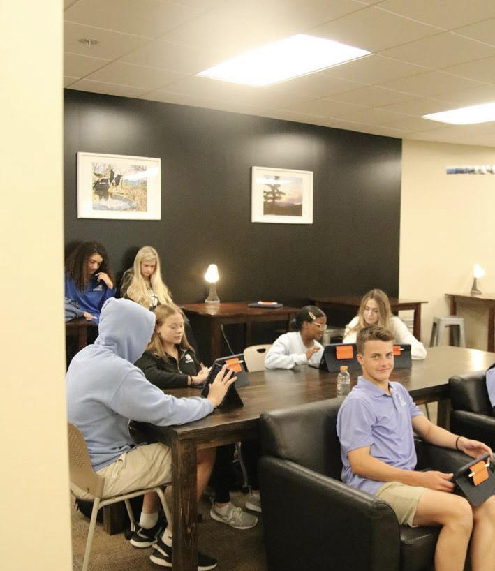 Students in the new Business Lab, learning about marketing on first day of school.