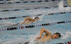 John Galakatos, sophomore, and Ahren Muehleisen, junior, work on their freestyle stroke at practice.