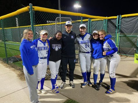 (Left to right) Katie Pederson, Hope Linam, Kennedy Pearson, Victoria Fuller, Emma Yost, and Savvy Duncan, seniors, commemorate their last game with Coach Petke.