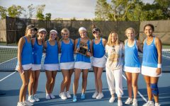The girls tennis team poses after placing first in their district.